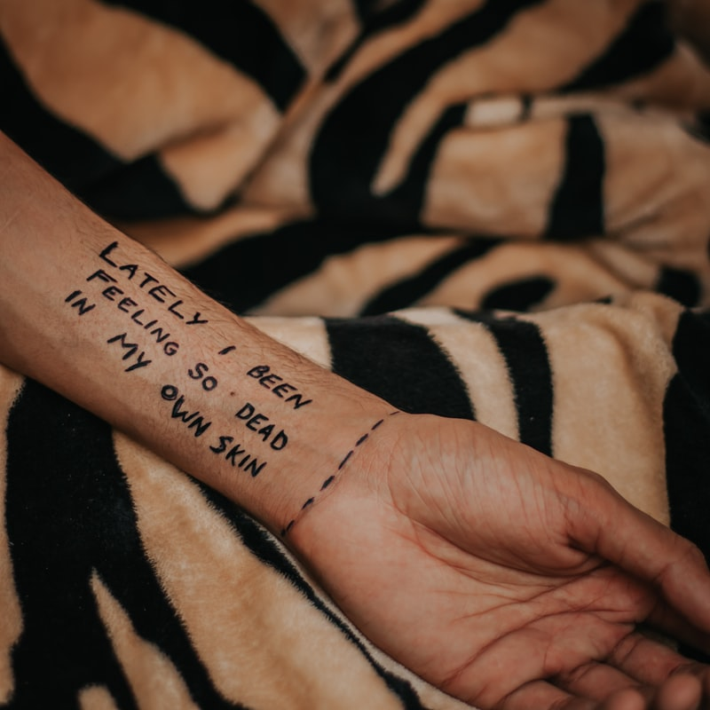 Hand with depression quotes written