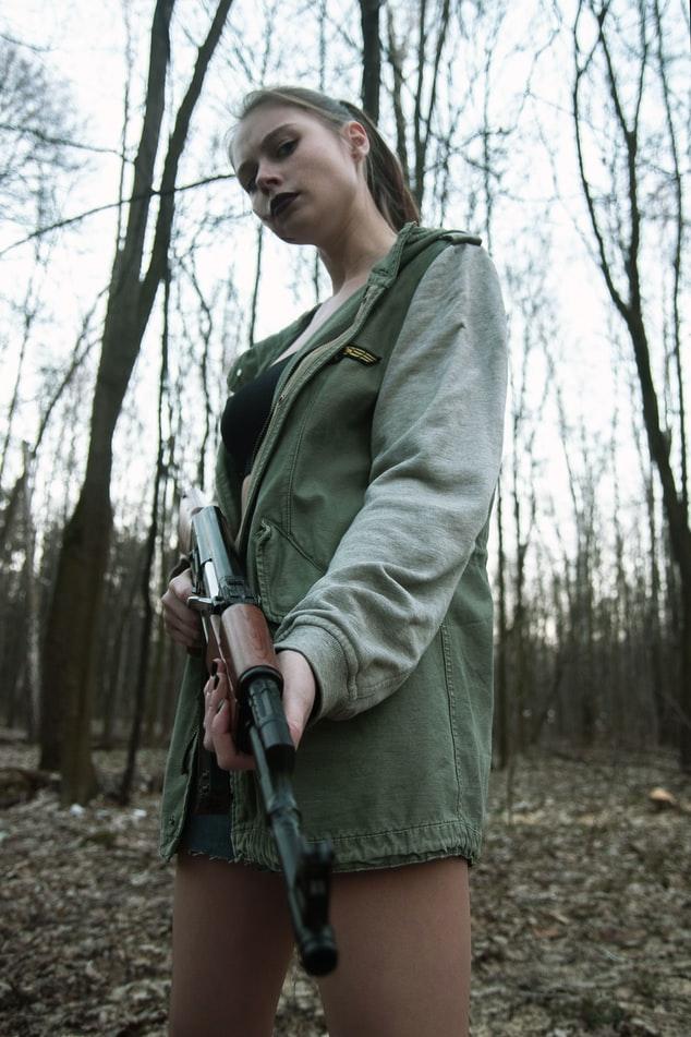 Woman holding Ak-47 Riffle