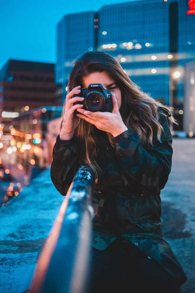 Girl clicking a picture from a DSLR Camera